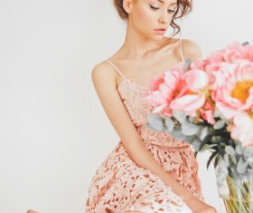 Beautiful young woman with bouquet of peony Stock Photo 06