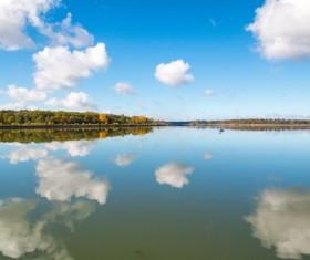 Blue sky white clouds lake reflection Stock Photo
