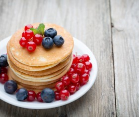 Blueberry cherry pancakes decorated Stock Photo