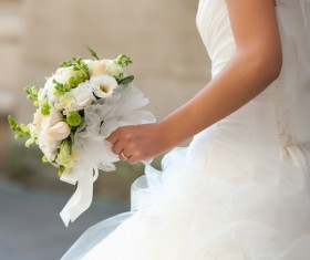 Bride holding bouquet of flowers Stock Photo