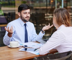 Business discussion of men and women Stock Photo 03