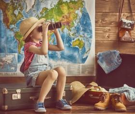 Children playing with binoculars Stock Photo