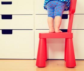 Children standing on chairs Stock Photo