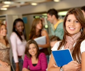 College students holding books Stock Photo
