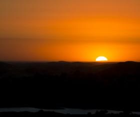 Dark sunset on mountain range Stock Photo