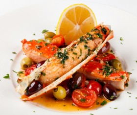 Delicious crab legs with lemon olives Stock Photo