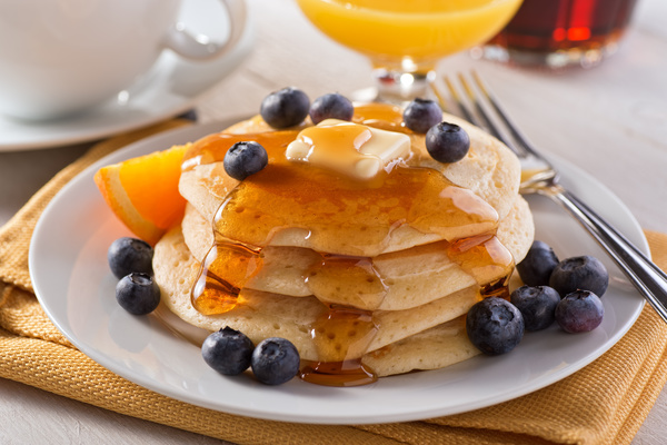 Delicious honey pancake with blueberry decoration Stock Photo