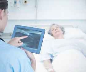 Doctor working with tablet in hands Stock Photo 01