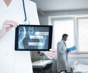 Doctor working with tablet in hands Stock Photo 03