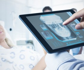 Doctor working with tablet in hands Stock Photo 04