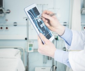 Doctor working with tablet in hands Stock Photo 06