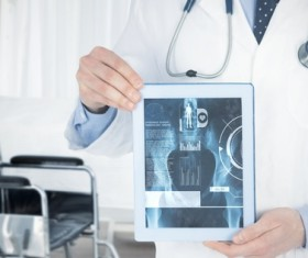 Doctor working with tablet in hands Stock Photo 07