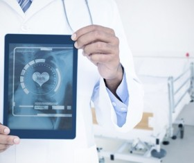Doctor working with tablet in hands Stock Photo 08