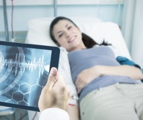 Doctor working with tablet in hands Stock Photo 09