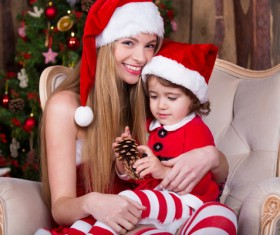 Dressed in Christmas clothing mother holding son Stock Photo