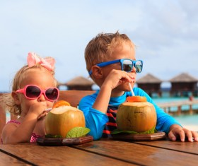 Drink coconut juice brother and sister Stock Photo