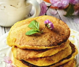 Floral decorated pancakes Stock Photo