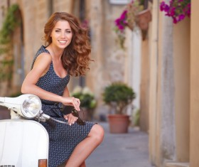 Girl sitting on the motorcycle Stock Photo 02