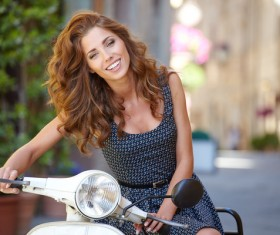 Girl sitting on the motorcycle Stock Photo 03