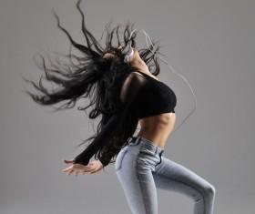 Girl with headphones dancing Street dance Stock Photo