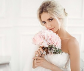 Hand holding bouquet of beautiful bride Stock Photo