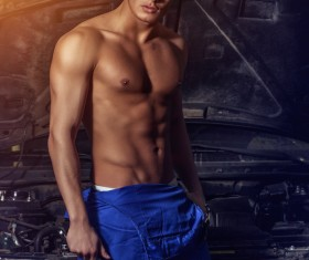 Handsome and strong car mechanic Stock Photo