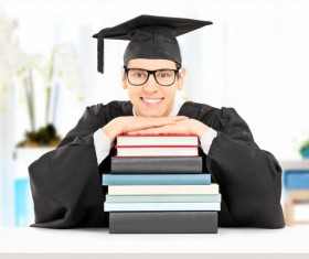 Happy graduates wear academic dress Stock Photo