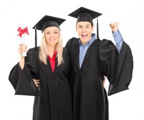 Happy male and female graduates posing Stock Photo