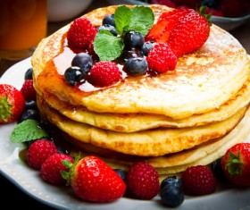 Honey delicious fruit pancakes Stock Photo