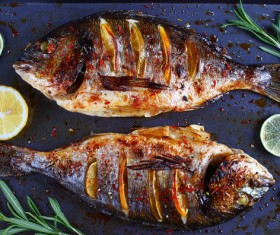 Lemon roasted fish Stock Photo