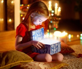 Little girl opening Christmas gift Stock Photo