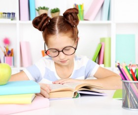Little girl reading seriously Stock Photo