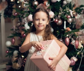 Little girl receiving gifts on Christmas Day Stock Photo 01