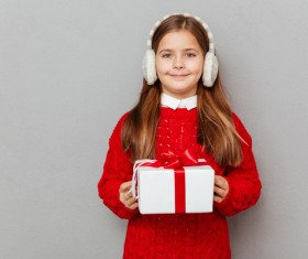 Little girl receiving gifts on Christmas Day Stock Photo 02