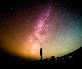 Looking alone at the stars Stock Photo