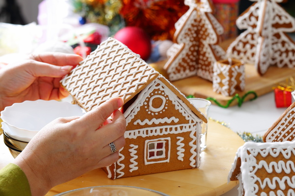 Making Christmas cookie house Stock Photo 03