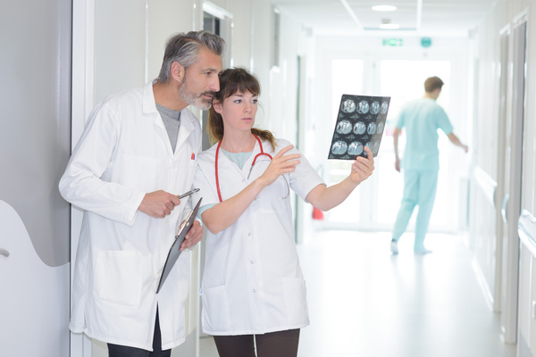 Male and female doctors to see X ray film Stock Photo