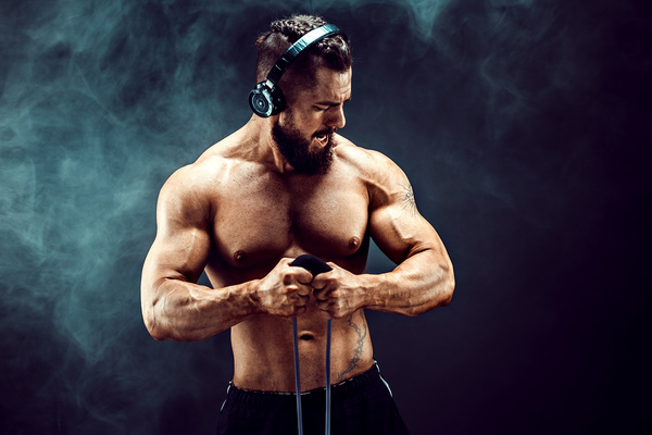 Men with stretching exercise with headphones Stock Photo