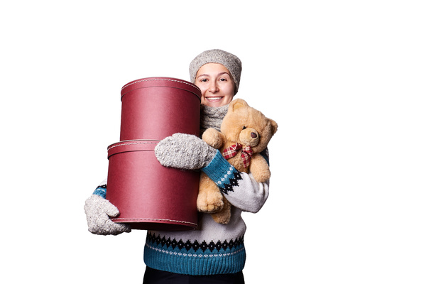 Middle aged woman holding teddy bear and gift box Stock Photo