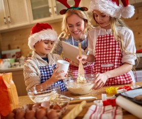 Mother and child make Christmas food together Stock Photo