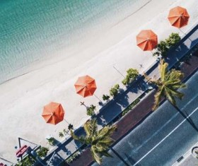 Overhead umbrellas on the beach Stock Photo