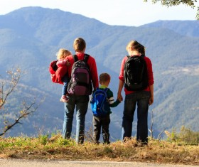 Parents who climb mountains with their children Stock Photo