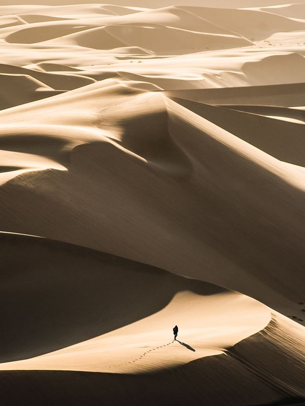 People walking in the desert Stock Photo
