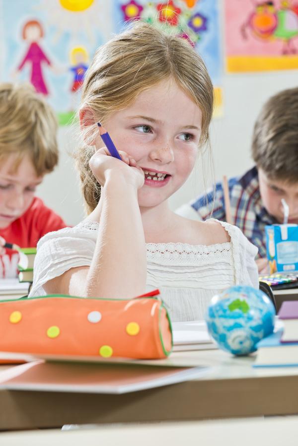Pupils biting a pencil Stock Photo