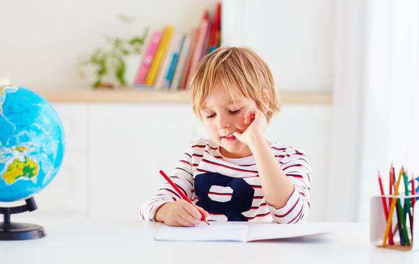 Pupils doing homework Stock Photo