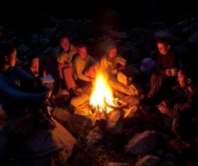 Sitting around the campfire Stock Photo