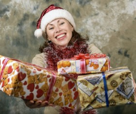 Smiling senior man holding Christmas present Stock Photo