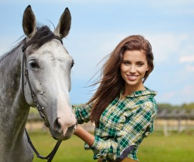 Smiling woman hold horse Stock Photo
