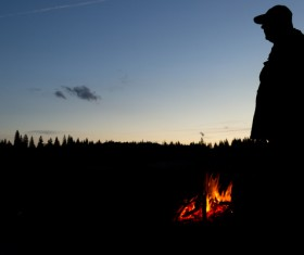 Standing next to the campfire Stock Photo