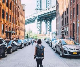 Street female backpackers Stock Photo